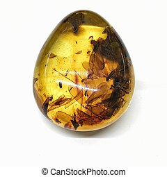 Pendant from a piece of transparent Baltic amber with insects inside.