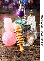 Pendulum and crystals - Pendulums.Wooden, crystal pendulum,...