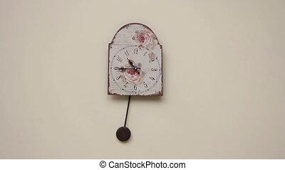 pendulum clock on the wall