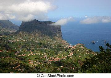 Penha d'Aguia (Eagle's rock) and Porto da Cruz Madeira from a ridge near Portella