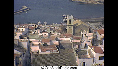 Peniscola cityscape panorama from the top overlook of the walled city with houses and buildings. Historical Peniscola sea town of Spain in the 1970s.