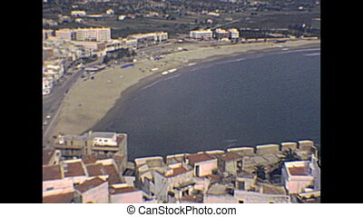 Peniscola seascape panorama from top towers of the walled city. Historical Peniscola sea town of Spain in 1970s.