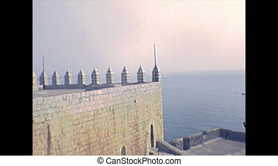 cityscape panorama of Peniscola from top walls of the city. Historical Peniscola sea town of Spain in 1970s.