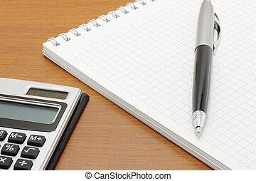 penna, blocco note, calcolatore