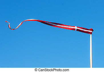 Pennant with the flag of Denmark blowing in the wind