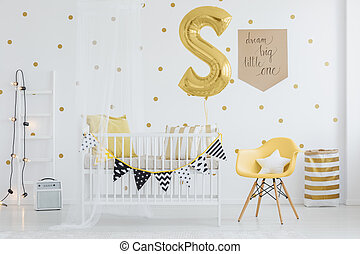 Pennants hanging on crib