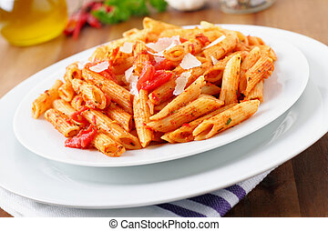 fresh pasta with a hot tomato sauce and parmesan cheese.