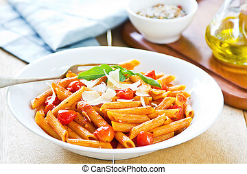 Penne with tomato sauce and shaving Parmesan on top