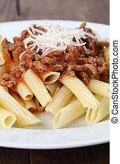 Penne pasta with bolognese sauce and cheese