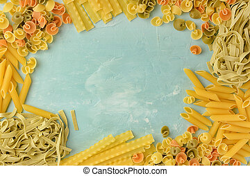 Penne, Mafalde, Tagliatelle, Spaghetti lined in a frame on a blue background. Beautiful composition of pasta with space for text, copy space.