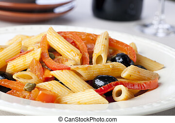 Penne pasta dinner with red bell peppers and black olives