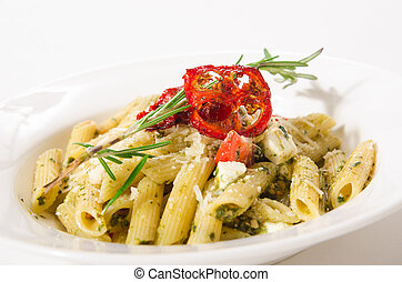 Penne Pasta with cheese feta, spinach, pesto and sun-dried tomatoes