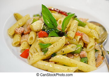 Penne pasta with ham and basil, Italian food.