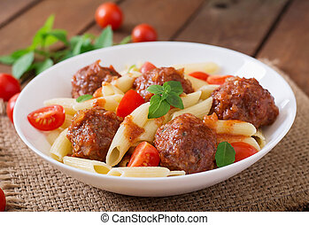 Penne pasta with meatballs. - Penne pasta with meatballs in...