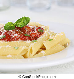 Penne pasta with Napoli tomato sauce noodles meal on a plate