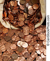 New pennies spilling out of a vintage canvas coin bag.
