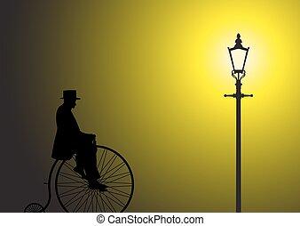 Penny Farthing Gentleman In The Street Light