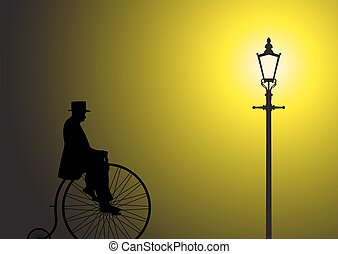 Penny Farthing Gentleman In The Street Light