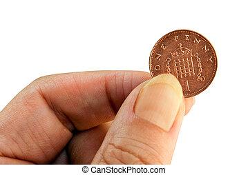 Female hand holding new penny (UK). Isolated.