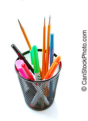 Pens and pencils in metal mesh pencil holder on white background