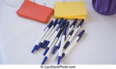 Pens, paper for notes are on table. Close-up - Wedding...