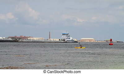 Pensacola Bay Boating - Teen paddles his kayak on Pensacola...
