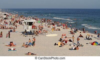 Pensacola Beach Vacationers - Vacationers relax and sunbath...
