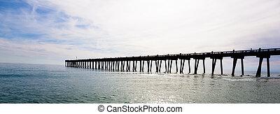 Pensacola pier with sun shining through - The Pensacole pier...