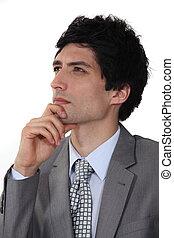 pensativo, jovem, homem negócios