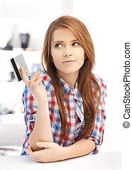 pensativo, menina adolescente, com, cartão crédito
