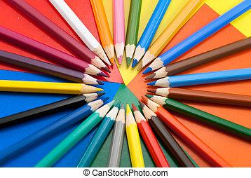 Pensil - Multi-colored pencils lie on a color cardboard