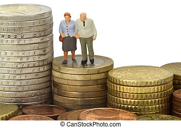 Pension - Figurine from senior couple with eruo coins on...