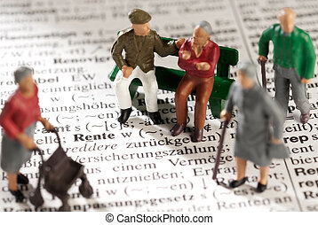 Pension - Model figures of old people on a dictionary with ...