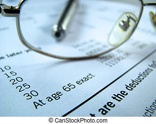 A pension plan form with glasses and pen
