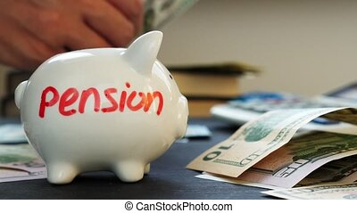 Pension written on a piggy bank and hands counting money....