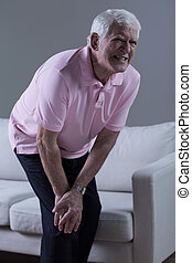 Pensioner having knee arthritis - Vertical view of pensioner...