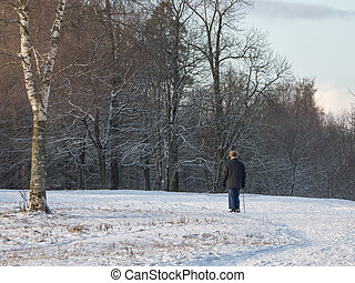 Pensioner on a winter walk in the Park.
