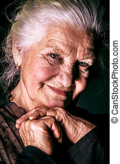 pensioner - Portrait of a happy senior woman smiling at the ...