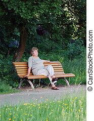 pensioner sitting alone in park