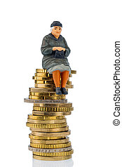 pensioner sitting on a pile of money, symbolic photo for pensions, retirement, old age