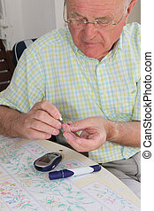 Pensioner taking blood sample - Elderly pensioner wearing ...