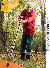 Pensioner working in garden