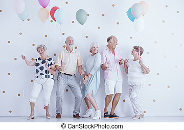 Pensioners dancing at party