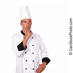 Pensive 20-24 years male chef standing - Portrait of pensive...