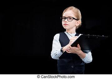 Pensive adorable girl with folder on black
