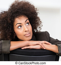 Pensive African American businesswoman with curly afro hair...