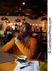 Pensive African-American Man in cafe