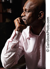 Pensive african man sideview
