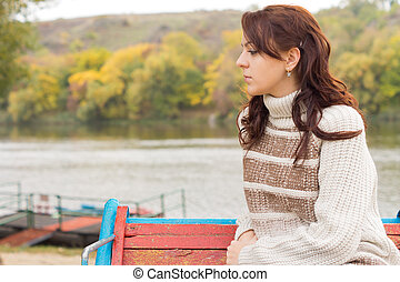 Pensive attractive young woman outdoors