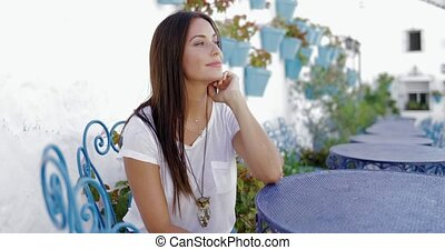 Pensive beautiful model at table - Young charming brunette...